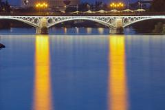 Sotto il ponte / Under the bridge (Seville, Andalusia, Spain) (AndreaPucci) Tags: seville andalusia spain triana bridge guadalquivir river night andreapucci