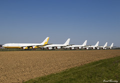 A340 Line Up (birrlad) Tags: tarbes lourdes lde airport france aircraft aviation airplane airplanes airline airliner airlines parked taxiway storage stored airbus