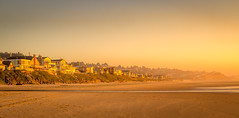 Hazy Late Afternoon Sunset (allentimothy1947) Tags: lincolncity oregon adobe afternoon beach footprint goldenhour hazy houses istock light sand shutter sky sunset water