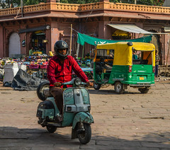 A man riding Vespa on street (phuong.sg@gmail.com) Tags: asia blue city colored crowd culture cute delhi door elegance india indian life motor motorbike motorcycle object old oldfashioned past piaggio pollution poverty rajasthan retro revival road scene scooter small speed street traditional traffic transport transportation urban vespa village vintage wheel yellow