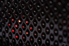 Fire in the Hole (PhilR1000) Tags: macromondays hole grater kitchen utensil metal redlight pattern sharp