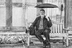 In the Garden on a Rainy Day (WilliamND4) Tags: sliderssunday nikon d750 rain umbrella man