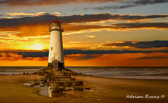Point of Ayr Lighthouse Sunset (Adrian Evans Photography) Tags: horizon rock rail window seashore water door hdr beach maritime decay uk tourism british pointofayr architecture disused worn wales waves white shore lighthouse tower navigation landscape sunset talacre old landmark northwales sky outdoor vacation evening abandoned light sea sand red coastline steps ocean nautical cloud europe clouds flintshire seascape pointofayre coast adrianevans coastal