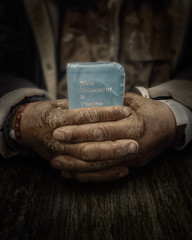 War and Peace (mckenziemedia) Tags: bible hands worn wrinkles vintage iphone shotoniphone brown blue homeless homelessness book skin table