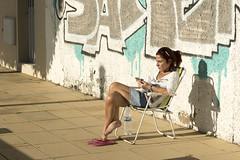 Woman enjoying the sun (Jan van der Wolf) Tags: map16770v woman vrouw girl sun zon genieten enjoy chair stoel streetphotography straatfotografie wall muur arinaga grancanaria shadow shadowplay