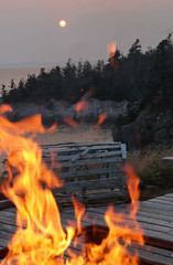 Deck Flames (peterkelly) Tags: digital canon 6d northamerica canada newfoundlandlabrador cavendish trinitybay deck lobstertrap sunset sun evening dusk water flames heat hot lit fire whitepoint