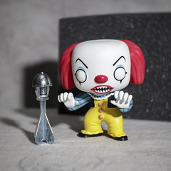 Pennywise is now in possession of a Weapon of Mass Destruction - O Lawd ! (N.the.Kudzu) Tags: tabletop stilllife toy funkopop pennywise capbomb canoneosm lensbabytrio28 lightroom