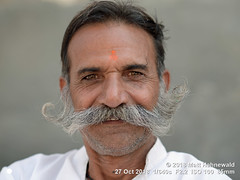 2013-11c Targeting Asia's Bold Menfolk (78) 2018 (06) (Matt Hahnewald) Tags: matthahnewaldphotography facingtheworld character head face forehead tilaka thirdeye eyes catchlights expression beard moustache stubble respect travel lifestyle pride traditional cultural village stranger mandawa shekhawati rajasthan india asia asian indian rajasthani rural male man portraiture detail nikond610 nikkorafs85mmf18g 85mm resized 1200x900pixels horizontal street portrait closeup headshot fullfaceview outdoor colour posing authentic smiling rugged manly friendlymuttonchops clarity person humour 4x3ratio consensual middleaged lookingatcamera