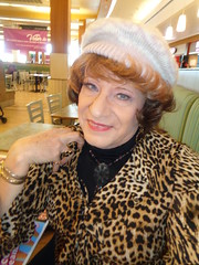 Taking A Break From Checking Out Sales On A Sunday Morning (Laurette Victoria) Tags: shopping auburn woman laurette animalprint southridge milwaukee hat