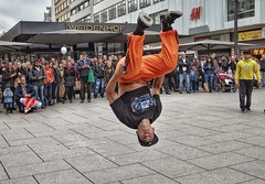 Street performer breakdancing in front of the random crowd.  Frankfurt,  DE (elnina999) Tags: city dance style breakdance acrobat male flip air crowd frankfurt germany downtown nikond5100 outdoors busking cool exercise travelphotography falltraveltoeurope performance skilled athletic boy