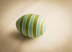 Easter Egg Racing Stripes (SoS) (13skies) Tags: smileonsaturday egg stripes easter easteregg negativespace alone itself byitself theme table windowlight sonya57 minimaleggtic