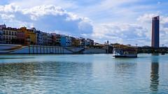 Guadalquivir, Sevilla (joannab_photos) Tags: spain sevilla colors reflection tower boat guadalquivir