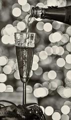 Prosit... (jueheu) Tags: sekt schaumwein champangner glas flasche weihnachtsbaum christmastree bokeh schwarzweis sepia bw blackandwhite stimmungsvoll emotion
