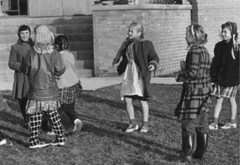 Quiet play (theirhistory) Tags: child kid girl school class form pupils coat dress skirt shoes wellies play rubberboots