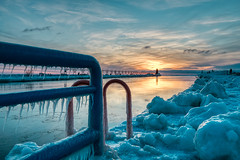 South Haven Lighthouse #14 (tquist24) Tags: hdr lakemichigan michigan nikon nikond5300 people southhaven southhavenlighthouse catwalk clouds cold evening fence frozen geotagged ice icicle icicles lighthouse pier reflection reflections seascape sky sunset water winter