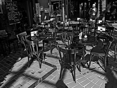 an untold story... (j.p.yef) Tags: peterfey jpyef yef bw sw monochrome restaurant cafe shadow light inside germany hamburg hitchcock woman tables chairs people man mood sun aoi elitegalleryaoi bestcapturesaoi