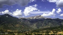 Manitou Springs and Pikes Peak (woodchuckiam) Tags: manitousprings colorado pikespeak manitouspringsincline sky clouds peak mountains mountainsides cliffs forests hikingtrail town cograilway pikespeakcograilway scenic landscape kodachrome woodchuckiam