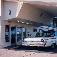 Roadrunner Lodge Motel, Tucumcari, NM 88401 (Terrorkitten) Tags: tucumcarinm170328usahasselblad07011 philbebbington terrorkitten roadrunnerlodgemotel tucumcari nm newmexico 88401 hasselblad501cm kodakfilm kodakektar route66 fordgalaxie