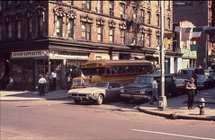 Several older guys in white shirts mill around around the Grand Superette while a cool 1969 Buick Riviera waits for the light at the corner of Grand and Mott Streets. Little Italy. New York. June 1970 (wavz13) Tags: newyorkphotographs newyorkphotos urbanphotography urbanphotos newyorkphotography manhattan manhattanphotography oldbuildings vintagebuildings analog vintageanalog oldphotographs oldphotos 1970sphotographs 1970sphotos oldphotography 1970sphotography oldnewyorkphotography oldnewyorkphotographs oldnewyorkphotos vintagenewyorkphotography vintagenewyorkphotographs vintagenewyorkphotos 19thcenturybuildings oldbuicks vintagebuicks antiquebuicks vintagecars vintagecar oldcar oldcars 1960scars 1970scars collectiblecars collectablecars vintagemanhattan oldmanhattan vintagenewyork oldnewyork manhattanskyline newyorkskyline 1970scar oldbuses oldschoolbuses vintageschoolbuses vintagebuses
