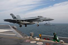 An F/A-18E Super Hornet aunches from the flight deck of the aircraft carrier USS John C. Stennis (CVN 74). (Official U.S. Navy Imagery) Tags: ussjohncstennis cvn74 uscentcom flightoperations fscassard d614 fa18esuperhornet arabiangulf