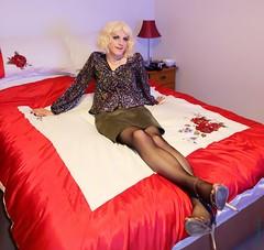 Bedded 1 (eileen_cd) Tags: bed highheelsandals stockings flowerblouse shortskirt blonde sitting crossdresser cd transvestite tv