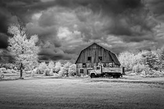 Old Truck and Barn in Ifrared near Lac St. Jean, Quebec (Steve Muise) Tags: infrared truck barn farm blackandwhite black white clouds sky dramatic