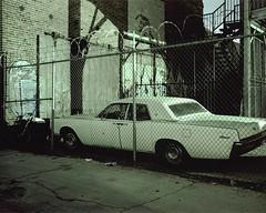 Lincoln (ADMurr) Tags: la eastside fence lincoln continental razor wire night 4x5 toyo 45cf lf kodak portra dba233