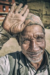 Welcome (Roberto Pazzi Photography) Tags: portrait people street eyes travel old man nepal face asia beard kathmandu elderly elder finger culture place photography cap glance hand one person closeup outdoor nikon smile
