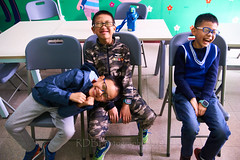 2019 Winter Camp Classroom Kids 09 (ArdieBeaPhotography) Tags: three boys classroom trio expresive silly funny feelings emotions chairs table tile floor wallmural drinkbottle waterbottle glasses watch camo pullover sweatervest anorak parka raincoat sweats jeans trainers faces grins teeth young preteen friends class foolingaround tamronspaf2875mmf28xrdildasphericalif
