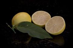 Fresh Lemons (brucetopher) Tags: lemon tree lemontree yellow sour lemons fruit citrus cut stilllife three 3 half halved leaf winter fresh