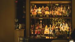 Liquor Pantry (yarnim) Tags: luxurycollection phoenicianresort phoenician phoenix arizona liquor bar indoor lowlight 85mm sony a7m3 a7iii ilce7m3 sel85f18 alcohol pantry hotel lounge moody bokeh bottles glass spg