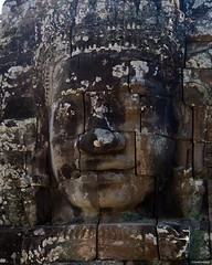 IMGP0888 Faces of Bayon (Claudio e Lucia Images around the world) Tags: angkor wat cambodia siem reap cambogia temple tempio khmer ancient asceta pentax pentaxkp pentax18135 pentaxlens pentaxart bayon entrance faces statue bridge naga stone heads angkorwat