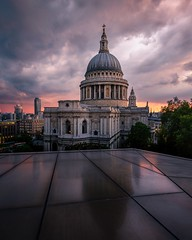 St Paul's Cathedral in London. (Andrew J Hulson) Tags: rooftop reflections unitedkingdom 1635mmf4 capitalofengland capitolofengland red orange purple britain cathedral nikon moodyskies england church stpauls uk london moody sunset