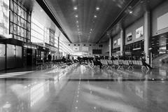 Departures (OzGFK) Tags: 35mm asia korea nikkor nikon rollei100 seoul analog blackandwhite bw film monochrome nikonf3t seoultrainstation