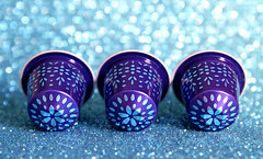 Temptation (Through Serena's Lens) Tags: smileonsaturday threesame three nespresso capsules coffee colorful purple blue bokeh closeup stilllife tabletop
