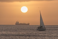 Tanker at Anchor (Fletch in HI) Tags: nikon d5600 tamron 16300 sunset sky ship boats clouds water ocean oahu bird