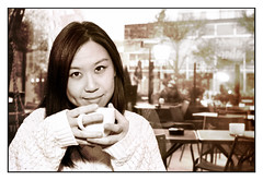 Woman with cup of tea in trendy, city bar - Sepia (Martyn.Hayes) Tags: tea coffee latte cappuccino cafe bistro diner bar pub drink hotdrink calm relaxing chilledout calming easygoing seat window daylight portrait woman portraiture tree nature day whitejumper model asian london greenwich rain wetweather indoors dry wet blackhair cosy warm comfortable whitesleeves hands cup mug hot rainonwindow damp raindrops