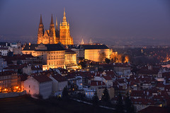 Prague Castle and St. Vitus Cathedral at night - 3 of 3 (Pavel's Snapshots) Tags: prague praha czech czechrepublic europe european travel tourism destination famous landmark place popular castle cathedral metropolitan gothic church temple palace illumination illuminated vivid evening dusk night twilight purple orange lighting sky houses town urban city roofs hill haze nikon nikkor d750 heritage aerial view winter towers spires ancient historical historic old medieval street lights 85mm royal residence valley