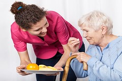 How to Persuade an Aging Adult to Eat (Home Care Assistance Roseville) Tags: home care service elderly nurse feed woman health food caregiver senior patient staff uniform plate fruit orange banana feeding female help doctor oranges ill healthy vitamin medical bananas fruits eat impairment take old disability ail healthcare crutch meal medicine takecare nursing support eating mealtime caring visit poland