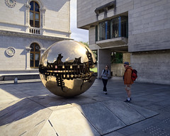 Sphere Square (Rev.Gregory) Tags: sferaconsfera sfera sphere spherewithinsphere arnaldo pomodoro trinity college dublin ireland square stone platform base pedestal reflection art appreciation city urban school shadow gold purple violet brutalism brutalist fedora backpack architecture clash sculpture