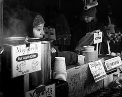 Apple Cider Seller (FourteenSixty) Tags: newyork nyc unionsquarepark unionsquare blackwhitephotos blackandwhite blackwhite monochrome manhattan candid people farmersmarket