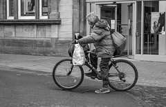 Coffee and cigarette (Photos taken with Sony mirrorless cameras) Tags: wrexham people street town pavement bike bicycle coffee smoking bags shopping