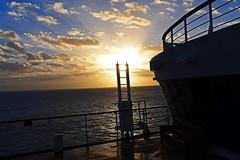 watching the sun rise (pontla) Tags: sunrise sun cruise clouds rays boat