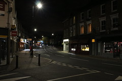 Night Shoot, 97 (doojohn701) Tags: buildings bus windows junction road streetlighting dusk dark shadow shops advertising reflection sky night village uk
