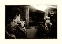 The Finishing Touch (Peter Dewhurst) Tags: tube underground makeup compact mirror lipstick train passengers girl boy people window nosmoking london trix film om1n d76 monochrome sepia bnw bw blackandwhite reportage street candid