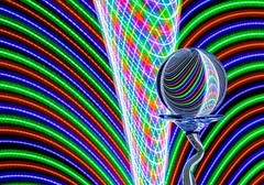 Vortex (Karen_Chappell) Tags: rgb red blue green led light lights black glass refraction stilllife longexposure lightpainting curve curves arc ball orb sphere round circle pink orange purple white multicoloured abstract colourful colours colour color