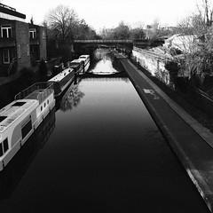 (a.pierre4840) Tags: olympus om2n zuiko 24mm f28 35mmfilm kodak kodaktrix trix bw blackandwhite monochrome noiretblanc 11 squareformat canal boats reflections bridge london england serene
