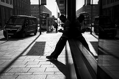 Silhouette, Shadow, Reflection (Leanne Boulton) Tags: urban street candid streetphotography candidstreetphotography streetlife man male mobile smartphone technology silhouette shadow reflection composition tone texture detail depthoffield bokeh naturallight outdoor light shade shape city scene human life living humanity society culture lifestyle people canon canon5dmkiii 35mm ef2470mmf28liiusm black white blackwhite bw mono blackandwhite monochrome glasgow scotland uk