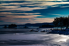 Layered (langdon10) Tags: norway randsfjorden water clouds forest ice islands rocks shoreline snow trees winter