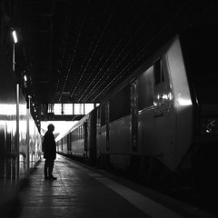 Looking at the train (pascalcolin1) Tags: paris13 austerlitz homme man train lumière light ombres shadows quay quai reflets reflection photoderue streetview urbanarte noiretblanc blackandwhite photopascalcolin 50mm canon50mm